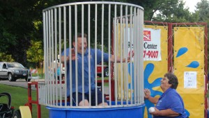Twin Lakes police Chief Dale Racer is dunked during his stint in the booth at last year's National Night Out event.