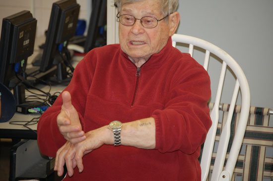 Holocaust survivor Paul Argiewicz shows students at Riverview School his concentration camp tattoo number in a presentation in 2012.