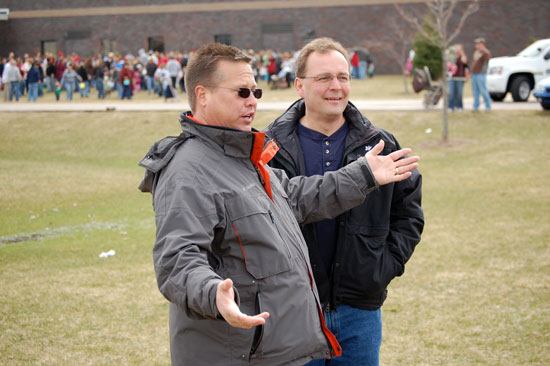 Tom Paddock, left, talks with Sheriff David Beth at the 2009 Westosha Kiwanis Easter Egg Hunt, just one of many Kiwanis community service projects he was instrumental in organizing.