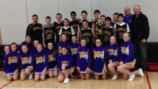 The Brighton School boys basketball A team and the cheerleading squad pose for a victory photo. /Submitted photo