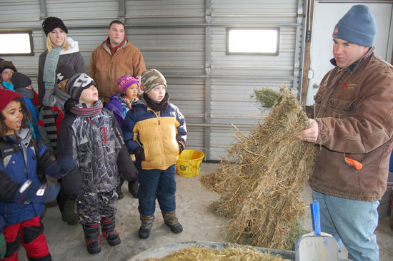 Paris students get a demonstration of what cows at Weis-Way Farm eat.
