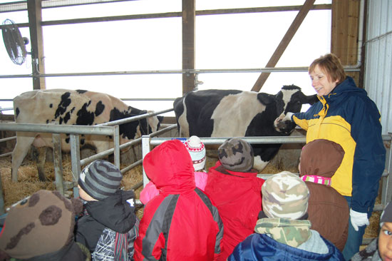 Marie Weis tells students about the calf born at her family's farm the day before.
