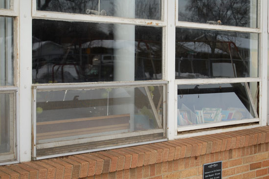 A firefighters opened these windows to help ventilate a classroom.