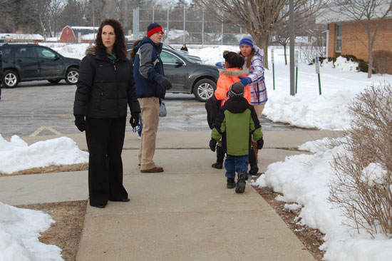 Principal Andrea Zackery and school staff direct students to Riverview's big gym where they were going to start the school day due to the smoke situation..