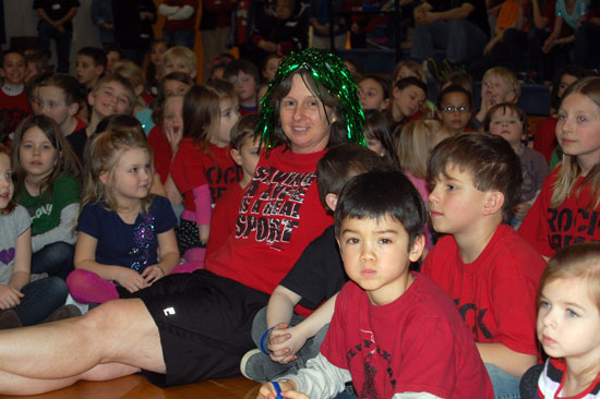 Gym teacher Chris Seymour  sits with students before the big shave.