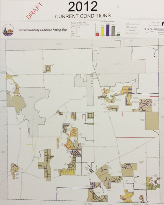 In his photo of a road condition map presented at the Salem annual town  meeting , red and yellow coded roads are in the worst condition.