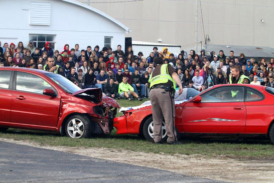 Wilmot Union High School students watch the pre-prom mock disaster at the school Thursday. /Earlene Frederick.