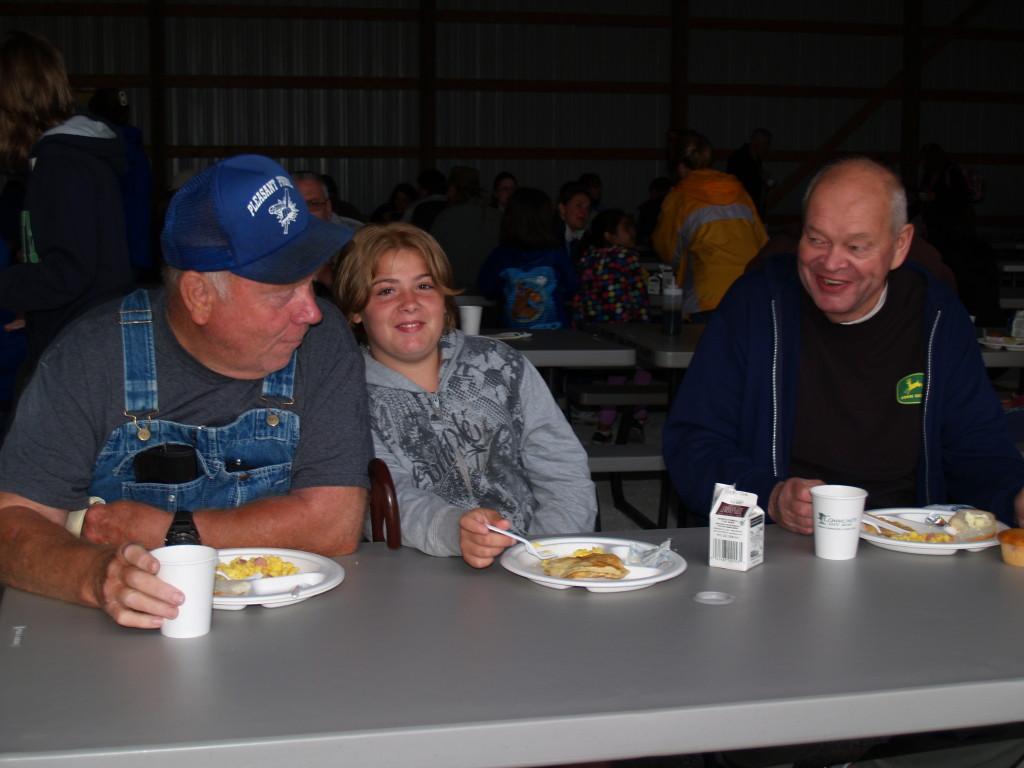 Eldon Moore and granddaughter Christina Formaroll of Trevor enjoy breakfast with family friend, Ray Jumisko of Winthrop Harbor, IL