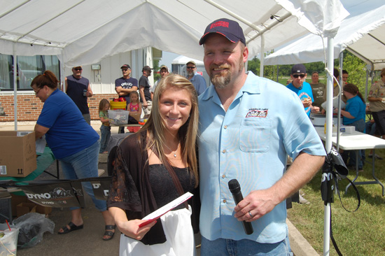 Bumper to Bumper scholarship winner from Wilmot Union High School Taylor Janssen and Bumper to Bumper owner Bob Reinke.