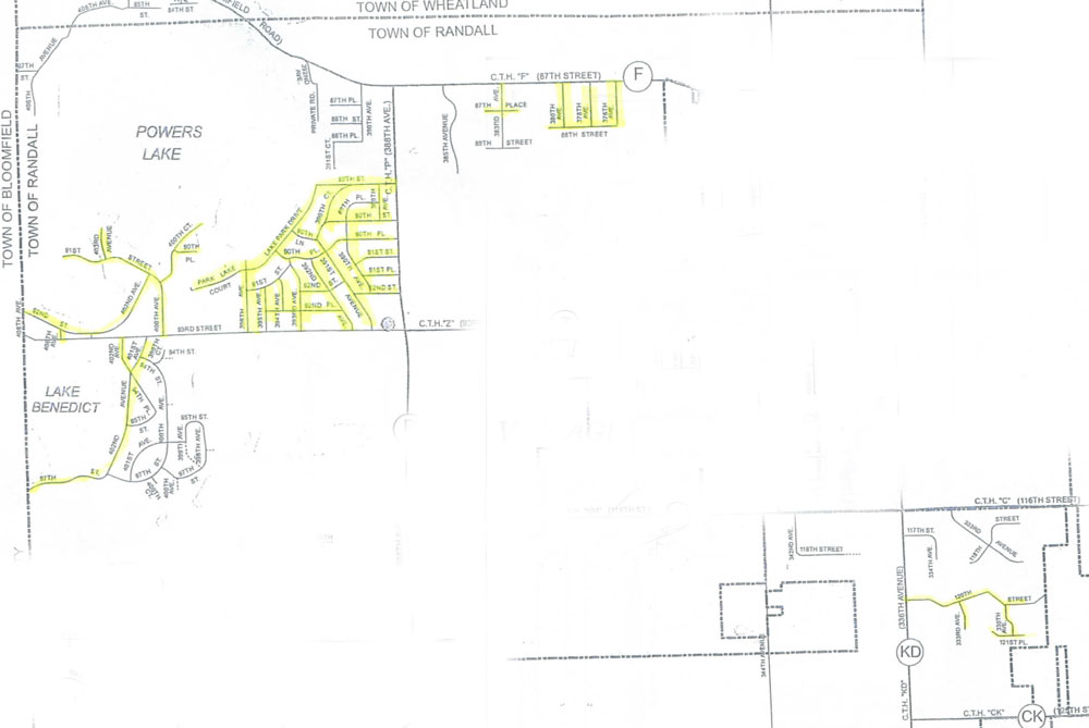 This two areas of Randall map (not contiguous) show in yellow highlight where the town will have crack sealing done. (Click for larger view)