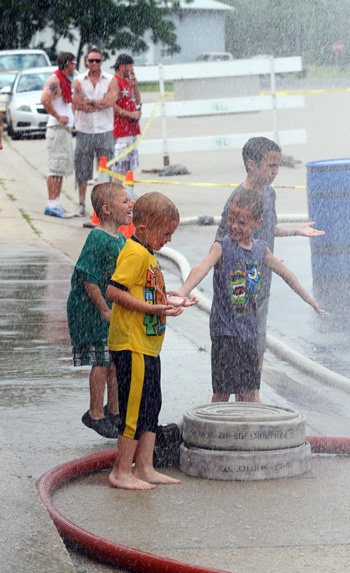 This youngster found their own way to enjoy the water fights. /Earlene Frederick photo