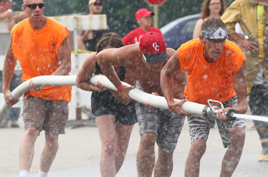 One of the teams in the water fights with teams from local businesses. /Earlene Frederick photo