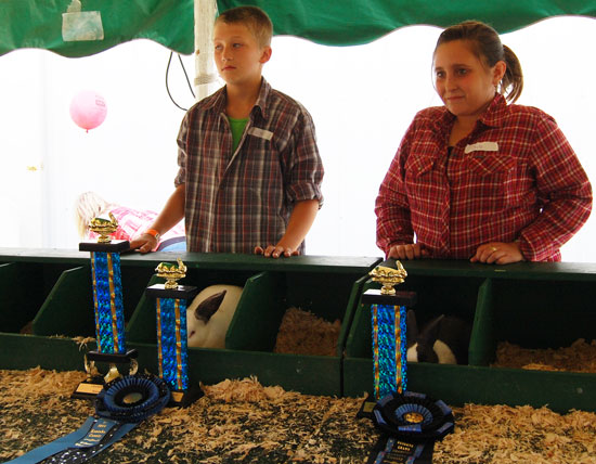 Best of show winner Matthew Knapp and best opposite of show winner Alessandro Lupo and their rabbits.