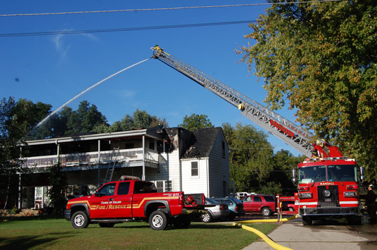 A Randall Fire Department puts water on the roof of the apartment building. This shows the north end of the building, where the fire started.