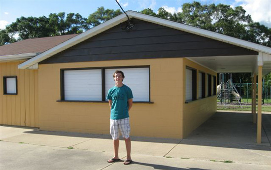 Gerald Ehr in front of the building at New Munster Park for which he organized a re-painting. /Submitted photo