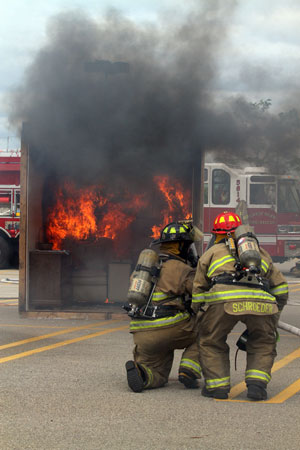 Town of Salem firefighters prepare to put out the burn room fire. /Earlene Frederick photo