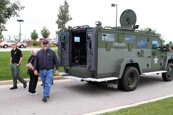County Supervisor Mike Underhill, of Paddock Lake, gets a look at the Sheriff's Department armored vehicle. /Earlene Frederick photo