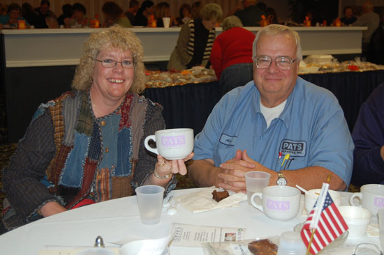 Marilyn and Alan Kaddatz display this year's Bowls 'n' Bakers commemorative soup cup. Kaddatz' business PATS Services Inc., is the event's primary business sponsor.