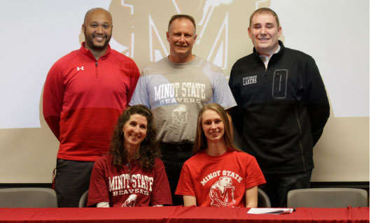 Kari at her signing with her parents Steve and Michelle Clements, Wilmot Head Coach Keiya Square, and  Wisconsin Lakers Coach Mike Elles. /Submitted photo