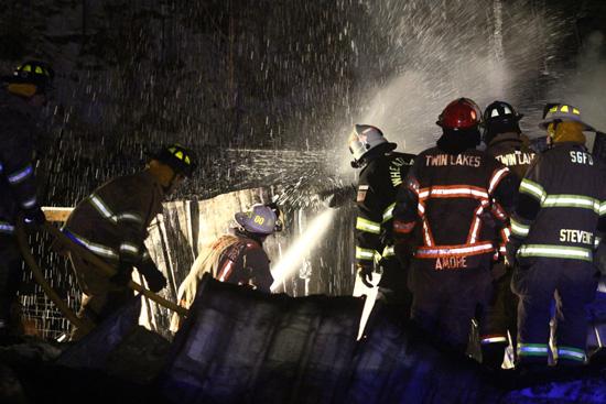 Firefighters spray foam. /Earlene Frederick photo