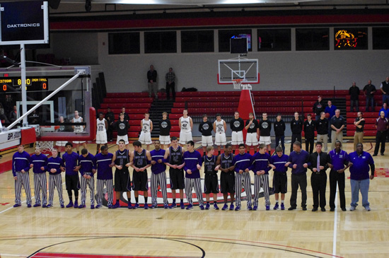 Central and Indian Trail line up for National Anthem. /David Thoss photo