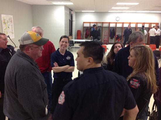 Brian Mickelson talks with some of the crew that helped save his life on Dec. 24, 2013.