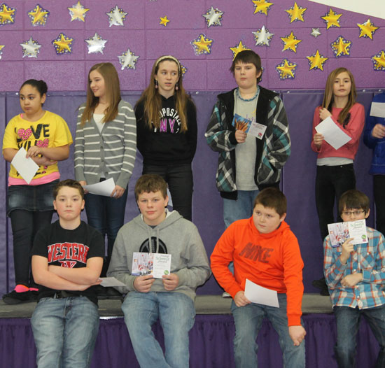 The sixth grade students that received awards included: (top) Isabelle Keen, Hannah Moat, Frank Bain, Kenna Beth, (bottom) Adam Seybert, Charlie Feeney, DJ Seward, and Caden Ryshkus. /Submitted photo