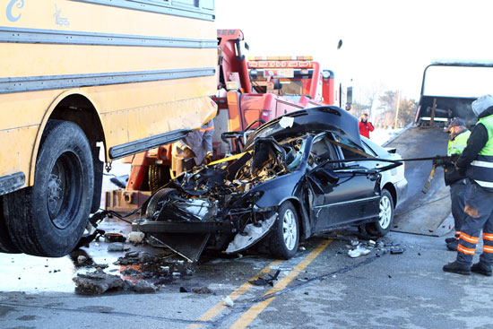 Bus hoisted to get car out. /Earlene Frederick photo