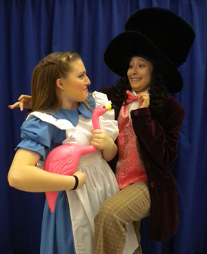 Alice, Hannah Kunce, is greeted by the Mad Hatter, Raquel Rivas, as she shows up uninvited at the Mad Tea Party. /Submitted photo