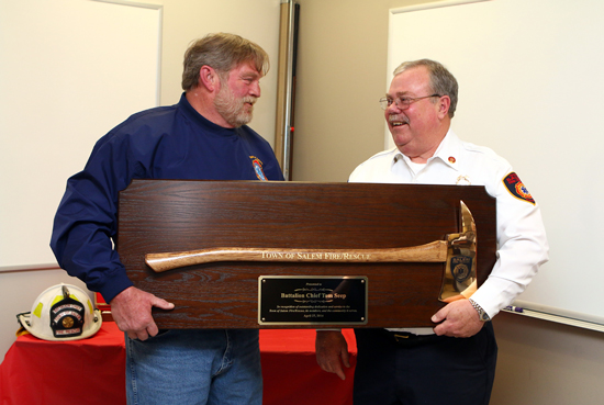 """Chief Mike Slover presented Seep a brass axe service award.  """"In recognition of outstanding dedication and service to the Town of Salem Fire/Rescue, its members, and the community it serves."""""""
