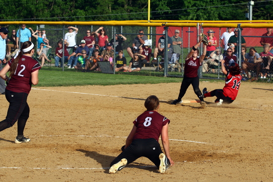She makes the throw to first, beating the runner.