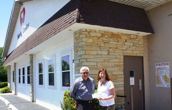 Community Foundation Executive Director Robert Schneider with Sharon Pomaville of the The Sharing Center. The Sharing Center received grants from the Foundation's Women's Fund, OMC Legacy Fund and unrestricted funds. /Contributed photo