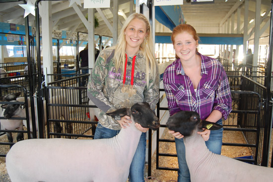 (from left) Michelle Knapp and Lauren Christensen, with their champion sheep.