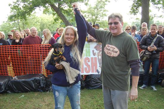 2014 Old Settlers Oktoberfest Dachshund Dash winner Ellie, her trainer Michelle Schroeder and County Executive Jim Kreuser.