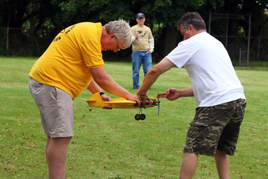 Dave Siegler and Chris Sterner, Greendale, help Joe Connelly get his plane airborne.