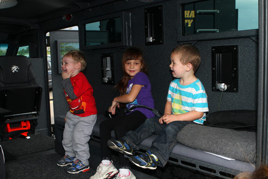 Kids loved climbing all over the Bearcat that was brought by the Kenosha Sheriff's Department.