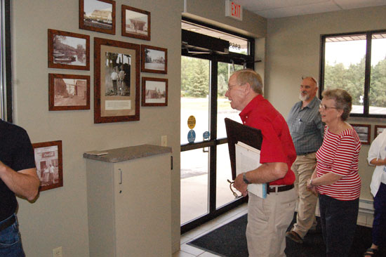 Jim Huntoon and Anette Siehoff look over some of the village's historical photos of the area. Village administrator Tim Popanda is in the background.