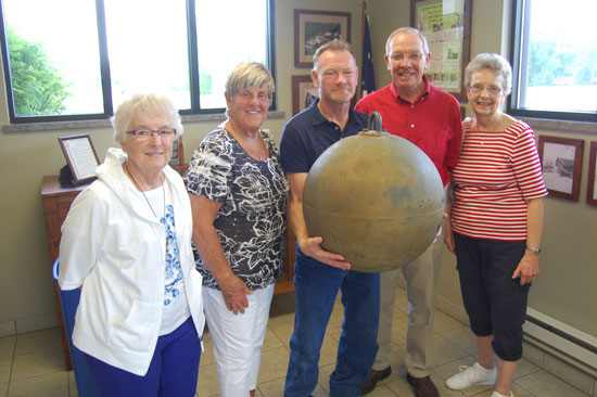 Posing with the old brass ball are (from left) Esther Huntoon, Trustee Barbara Brenner, village President Terry Burns, Jim Huntoon and Annette (Huntoon) Siehoff.