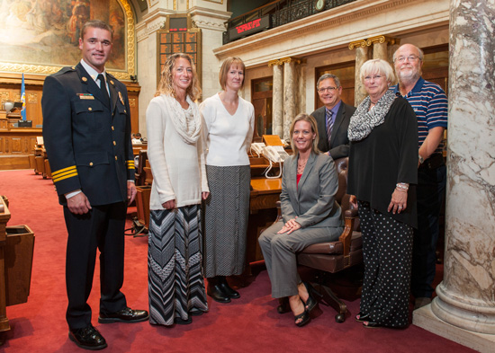 Friends and family of Lt. Scott Schumacher pose with state Rep. Samantha Kerkman on the floor of the Assembly chamber. /Contributed photo