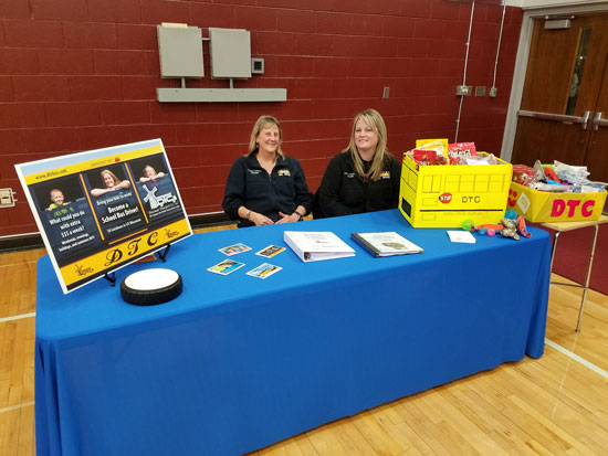 Dousman Transport drivers Sue Morton and Jessica Koltz collect dog food and toys for Meals on Wheels at a Central-Wilmot basketball double header.