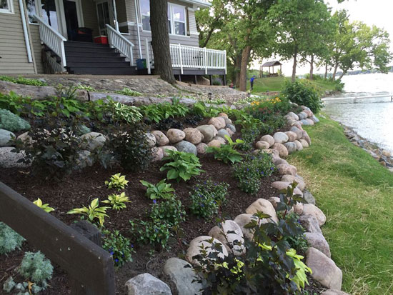 Tiered planting areas work well on sloping lots like at this bed and breakfast in Powers Lake.